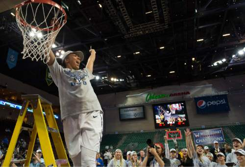 Rick Egan  |  The Salt Lake Tribune  Brigham Young Cougars guard Xojian Harry (11) holds up the net, after BYU defeated the San Francisco Dons 76-65, in the West Coast Conference Women's Basketball Championship game, at the Orleans Arena, in Las Vegas, Tuesday, March 10, 2015