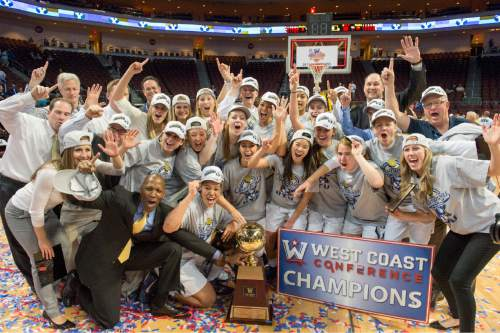Rick Egan  |  The Salt Lake Tribune  Brigham Young Cougars celebrate after defeating the San Francisco Dons 76-65, in the West Coast Conference Women's Basketball Championship game, at the Orleans Arena, in Las Vegas, Tuesday, March 10, 2015