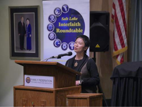 Mike Stack  |  Courtesy photo  Rev. Carmela Javellana-Hirano describes her conversion to Buddhism Tuesday at the Salt Lake Interfaith Roundtableís ìWomen of Faithî event.