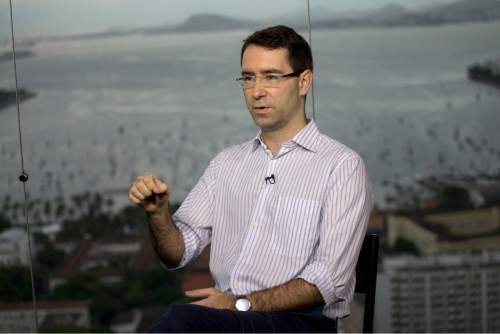 Project leader Joao Rego speaks during an interview with AP, in Rio de Janeiro, Brazil, Wednesday, March 11, 2015. Rego said Wednesday that the computer simulations provide an overview to make the job of collecting floating waste more cost-effective. But environmentalists say the government is not doing enough to fix rampant sewage pollution that originates in the 55 rivers that flow into the bay.  (AP Photo/Silvia Izquierdo)