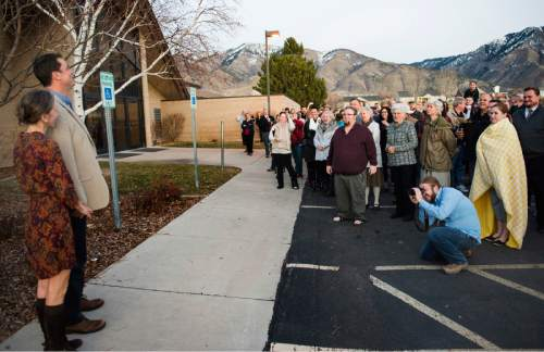 Rick Egan  |  The Salt Lake Tribune  John Dehlin and his wife Margi speak to a crowd of more than 200 people as they arrive at the North Logan LDS Stake Center for the disciplinary council in North Logan, Sunday, February 8, 2015