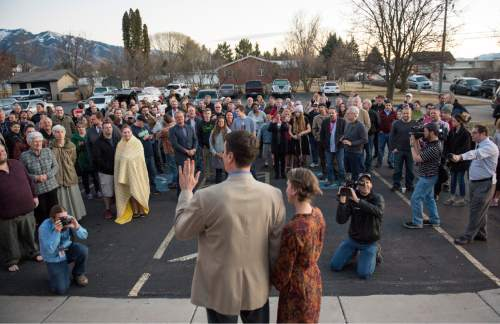 Rick Egan  |  The Salt Lake Tribune  John Dehlin and his wife Margi speak to a crowd of more than 200 people, as they arrive at the North Logan LDS Stake Center for the disciplinary council in North Logan, Sunday, February 8, 2015
