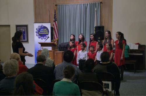"Mike Stack  |  Courtesy photo  Unification Church Youth Choir sings Tuesday at the Salt Lake Interfaith Roundtable's ""Women of Faith"" event."