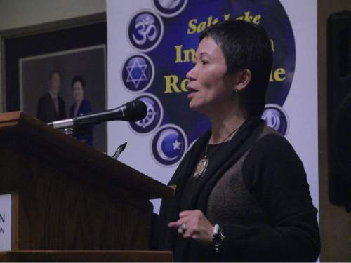 "Mike Stack  |  Courtesy photo   Rev. Carmela Javellana-Hirano describes her conversion to Buddhism Tuesday at the Salt Lake Interfaith Roundtable's ""Women of Faith"" event."