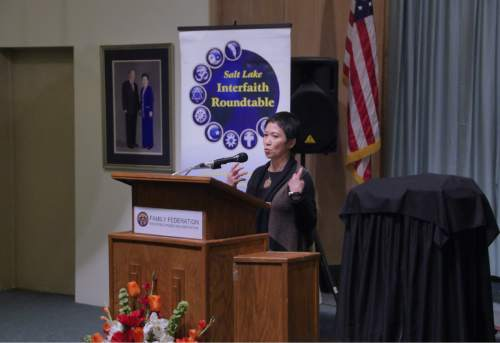 """Mike Stack     Courtesy photo   Rev. Carmela Javellana-Hirano describes her conversion to Buddhism Tuesday at the Salt Lake Interfaith Roundtable's """"Women of Faith"""" event."""