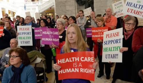 Al Hartmann  |  The Salt Lake Tribune  The Utah Health Policy Project, hundreds of citizens and advocates of the governor's plan to expand Medicaid, Healthy Utah rally at noon Thursday March 5, 2015, inside the Capitol rotunda.