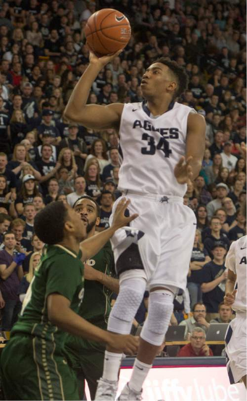 Rick Egan  |  The Salt Lake Tribune  Utah State guard Chris Smith (34) goes in for an easy two points for the Aggies, in basketball action, Utah State vs. Colorado State, in Logan, Saturday, March 7, 2015