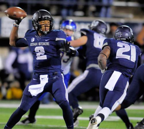 Utah State quarterback Kent Myers (2) throws the ball against San Jose State during an NCAA college football game, Friday, Nov. 21, 2014, in Logan, Utah. (AP Photo/The Herald Journal, Eli Lucero)