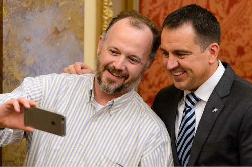 Trent Nelson  |  The Salt Lake Tribune House Speaker Greg Hughes, right, poses for a selfie in the House Chamber on the last night of the Utah legislative session at the State Capitol Building in Salt Lake City, Thursday March 12, 2015.