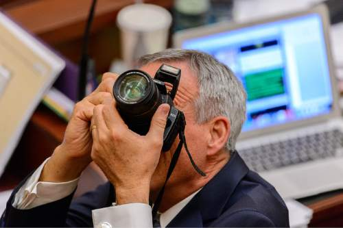 Trent Nelson  |  The Salt Lake Tribune Rep. Kay J. Christofferson, R-Lehi, takes a photograph in the House Chamber on the last night of the Utah legislative session at the State Capitol Building in Salt Lake City, Thursday March 12, 2015.