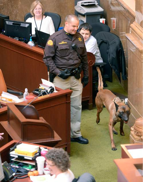 Al Hartmann  |  The Salt Lake Tribune  UHP K9 Officer Spencer Beardshall lets his partner Rocco, a bomb sniffing dog, inspect around the Speaker of the House podium in the Utah House of Representatives on the final day of the 2015 legislative session in Salt Lake City Thursday March 12.