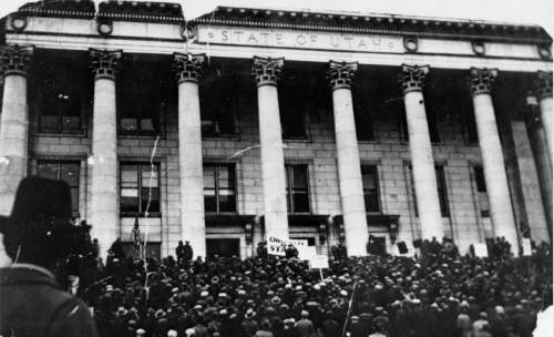Courtesy  |  Utah State Historical Society  Unemployed people rally on the steps of the Utah State Capitol, Feb.1932.