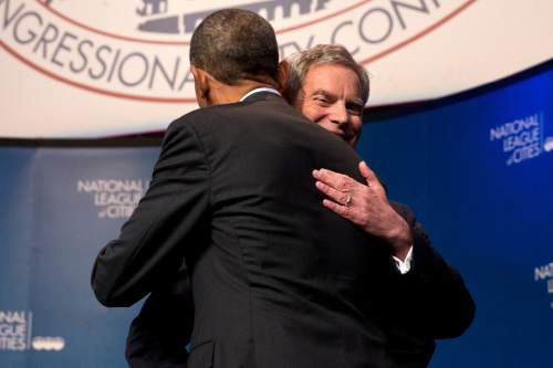 National League of Cities President, Salt Lake City, Utah Mayor  Ralph Becker hugs President Barack Obama at the National League of Cities annual Congressional City Conference in the Washington, Monday, March 9, 2015. (AP Photo/Jacquelyn Martin)