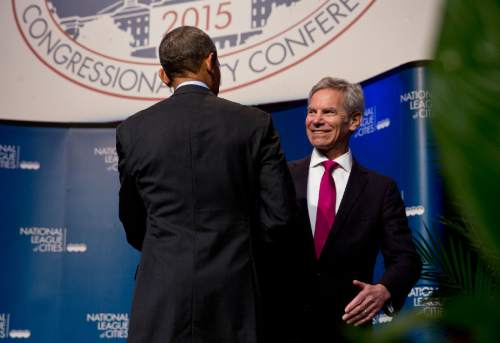 National League of Cities President, Salt Lake City, Utah Mayor Ralph Becker shakes hands with President Barack Obama at the National League of Cities annual Congressional City Conference in the Washington, Monday, March 9, 2015. (AP Photo/Jacquelyn Martin)
