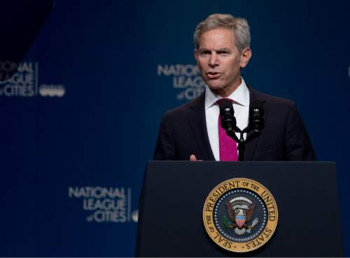 National League of Cities President, Salt Lake City Mayor Ralph Becker, introduces President Barack Obama at National League of Cities Congressional City Conference in Washington, Monday, March 9, 2015.  (AP Photo/Manuel Balce Ceneta)