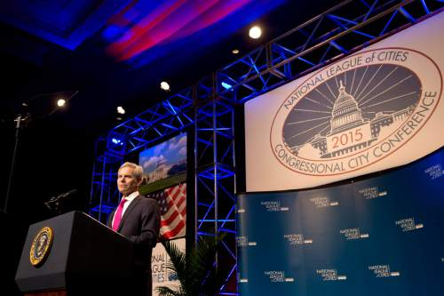 National League of Cities President, Salt Lake City, Utah Mayor Ralph Becker introduces President Barack Obama during the league's annual Congressional City Conference in Washington, Monday, March 9, 2015. (AP Photo/Jacquelyn Martin)