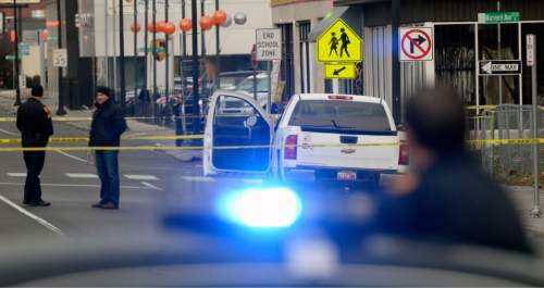 Al Hartmann  |  The Salt Lake Tribune File photo. Police investigate a shooting in Salt Lake City.