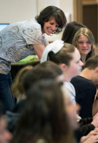Steve Griffin  |  The Salt Lake Tribune  Sand Ridge Junior High School teacher Jennifer Graviet works with her ninth-grade language arts class at the Roy school Friday, March 20, 2015.