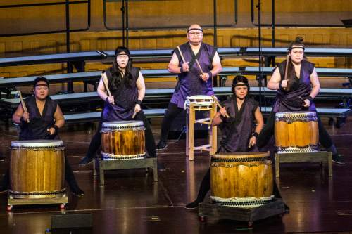 Chris Detrick  |  The Salt Lake Tribune Members of the Ogden Buddhist Temple Taiko, with Stan Hirei directing, perform during the annual Interfaith Musical Tribute at the Mormon Tabernacle Sunday March 22, 2015.  The Tribute originated the Sunday before the 2002 Winter Olympic Games as a time of prayerful reflection for religious leaders and others preparing to welcome the world to Salt Lake City. It returns every year on the anniversary of the Games and is the signature event of Interfaith Month in Utah.