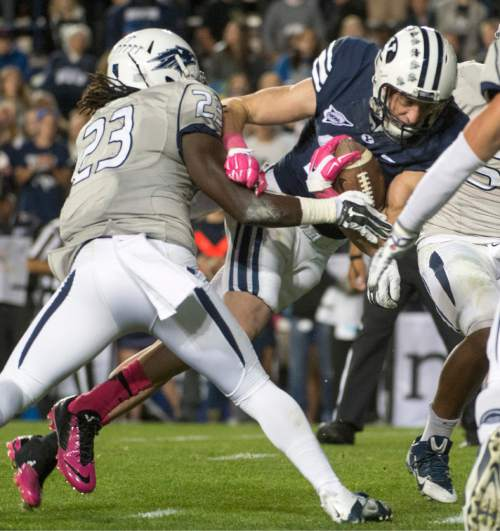 Rick Egan  |  The Salt Lake Tribune  Brigham Young Cougars wide receiver Mitch Mathews (10) gets past Nevada Wolf Pack defensive back Nigel Haikins (23)scores his second touchdown of the night, in football action, BYU vs The Nevada Wolf Pack at Lavell Edwards Stadium, Saturday, October18, 2014