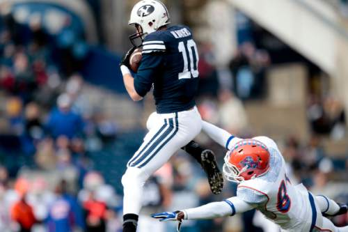 BYU wide receiver Mitch Mathews (10) hauls in a catch over Savannah State wide receiver Dylan Cook (84) during an NCAA college football Saturday, Nov. 22, 2014, in Provo, Utah. (AP Photo/The Daily Herald, Ian Maule) MANDATORY CREDIT