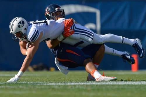 Chris Detrick  |  The Salt Lake Tribune Virginia Cavaliers safety Quin Blanding (3) tackles Brigham Young Cougars wide receiver Mitch Mathews (10) during the second half of the game at LaVell Edwards Stadium Saturday September 20, 2014.  BYU won the game 41-33.]
