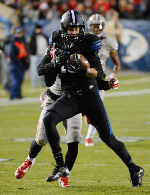 Steve Griffin  |  The Salt Lake Tribune  Brigham Young Cougars wide receiver Mitch Mathews (10) makes an acrobatic catch in front of UNLV Rebels defensive back Mike Horsey (32) )during first half action in the BYU versus UNLV football game at LaVell Edwards Stadium in Provo, Saturday, November 15, 2014.