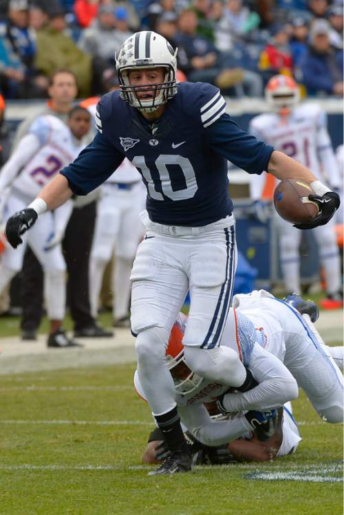 Leah Hogsten  |  The Salt Lake Tribune Brigham Young Cougars wide receiver Mitch Mathews (10) is brought down by Savannah State Tigers linebacker Justin Dixon (10). Brigham Young University leads Savannah State 51-0 at the half, November 22, 2014, at LaVell Edwards Stadium in Provo.