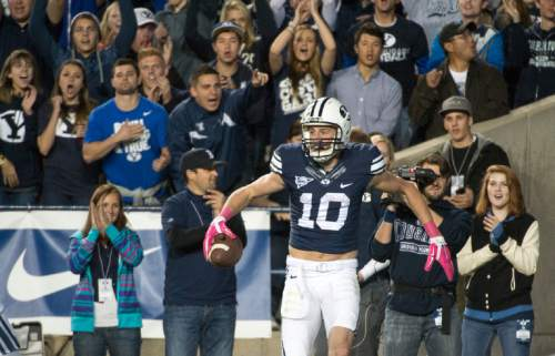 Rick Egan  |  The Salt Lake Tribune  Brigham Young Cougar fans celebrate with  wide receiver Mitch Mathews (10) after he scored a touchdown, in football action, BYU vs The Nevada Wolf Pack at Lavell Edwards Stadium, Saturday, October18, 2014