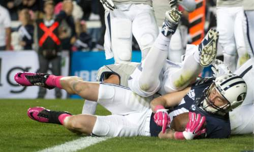 Rick Egan  |  The Salt Lake Tribune  Brigham Young Cougars wide receiver Mitch Mathews (10) scores his second touchdown of the night, in football action, BYU vs The Nevada Wolf Pack at Lavell Edwards Stadium, Saturday, October18, 2014