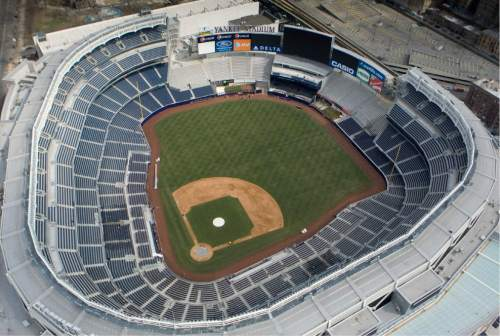 The new Yankee Stadium is shown in this aerial photo Sunday, March 22, 2009, in New York. The Mormon Tabernacle Choir will appear on the pregame lineup card on July 3, 2015, performing patriotic tunes and singing the national anthem. (AP Photo/Mark Lennihan)