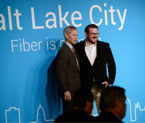 Al Hartmann  |  The Salt Lake Tribune  Salt Lake City Mayor Ralph Becker, left, and Devin Baer, Google's Assistant City Manager for Google Salt Lake City announce Salt Lake City as the next target city for Google Fiber, Tuesday March 24.  Google plans to design and build a fiber-optic internet network across the city, ultimately giving residents and businesses access to gigabit Internet speeds.