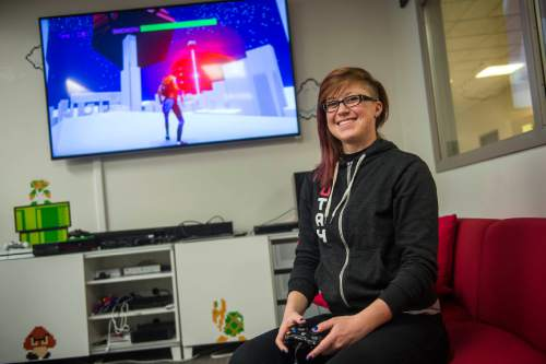 Chris Detrick  |  The Salt Lake Tribune University of Utah's Rachel Leiker poses for a portrait with her game 404Sight in the Merrill Engineering Building Tuesday March 24, 2015.  404Sight is a net neutrality game that will be available for free on April 16. The University of Utah's video game design program ranked top among graduate programs and number 2 for undergraduates in Princeton Review's.