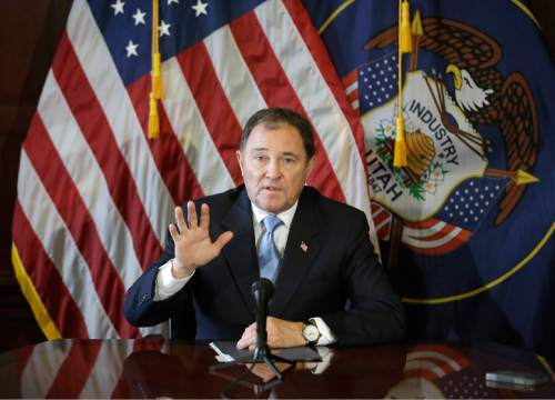"FILE - In this Feb. 5, 2015, file photo, Utah Gov. Gary Herbert speaks to members of the media during a news conference at the Utah State Capitol, in Salt Lake City. Utah became the only state to allow firing squads for executions Monday when Herbert signed a law approving the controversial method's use when no lethal-injection drugs are available. Herbert has said he finds the firing squad ""a little bit gruesome,"" but Utah is a capital punishment state and needs a backup execution method in case a shortage of the drugs persists. (AP Photo/Rick Bowmer, File)"