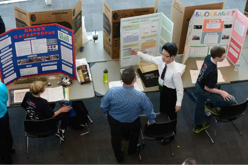 Scott Sommerdorf   |  The Salt Lake Tribune Wentao Zhang, from Midvale Middle School explains his project on computer encryption to a judge during the judging period of the Salt Lake Valley Science and Engineering Fair, held at the University of Utah, Wednesday, March 25, 2015.