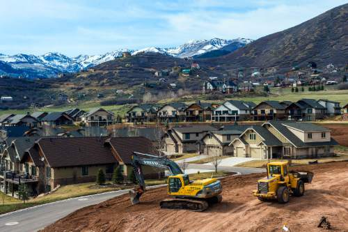 Chris Detrick     The Salt Lake Tribune Construction continues around homes in Midway Wednesday March 25, 2015.
