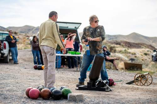 Chris Detrick  |  The Salt Lake Tribune Robert Kirby and friend Sonny shoot bowling balls out of a cannon in Rush Valley Saturday March 21, 2015.