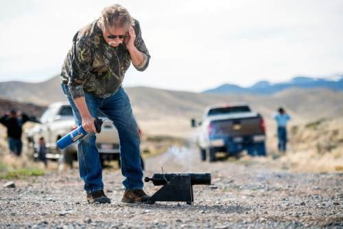 Chris Detrick  |  The Salt Lake Tribune Robert Kirby lights a cannon armed with a cement-filled coke can aimed at a clothes washer in Rush Valley Saturday March 21, 2015.