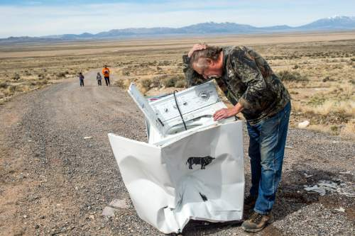 Chris Detrick  |  The Salt Lake Tribune Robert Kirby inspects the damage of the washing machine after shooting it with a bowling ball fired from a cannon in Rush Valley Saturday March 21, 2015.