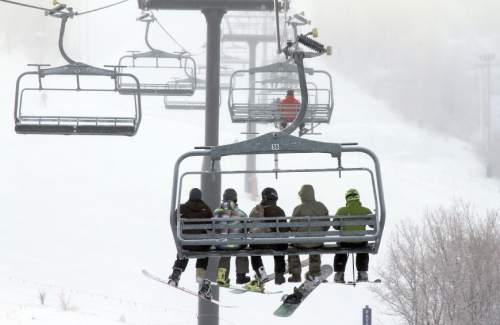 Francisco Kjolseth  |  The Salt Lake Tribune Skiers and snowbaorders ride the Payday lift in Park City Mountain Resort in 2012.