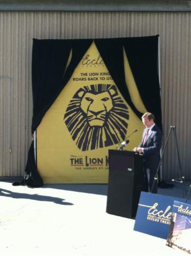 "Leslie Sorensen-Means  |  Special to the Tribune  Salt Lake County Mayor Ben McAdams unveils a poster for ""The Lion King,"" the first stage production at the now-under-construction Eccles Theater in downtown Salt Lake City, in a press conference Thursday, March 26."