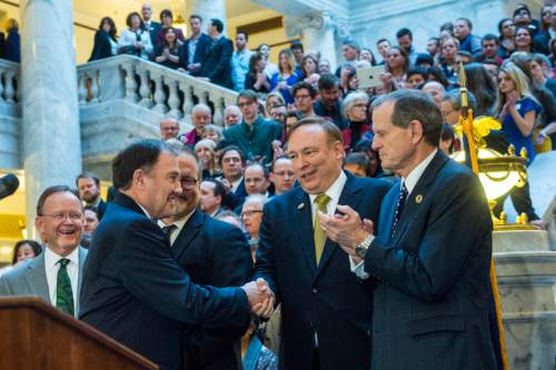 Chris Detrick  |  The Salt Lake Tribune Gov. Gary Herbert shakes hands with Sen. Jim Dabakis, D-Salt Lake, during the ceremony to sign SB296 at the Utah State Capitol Thursday March 12, 2015.