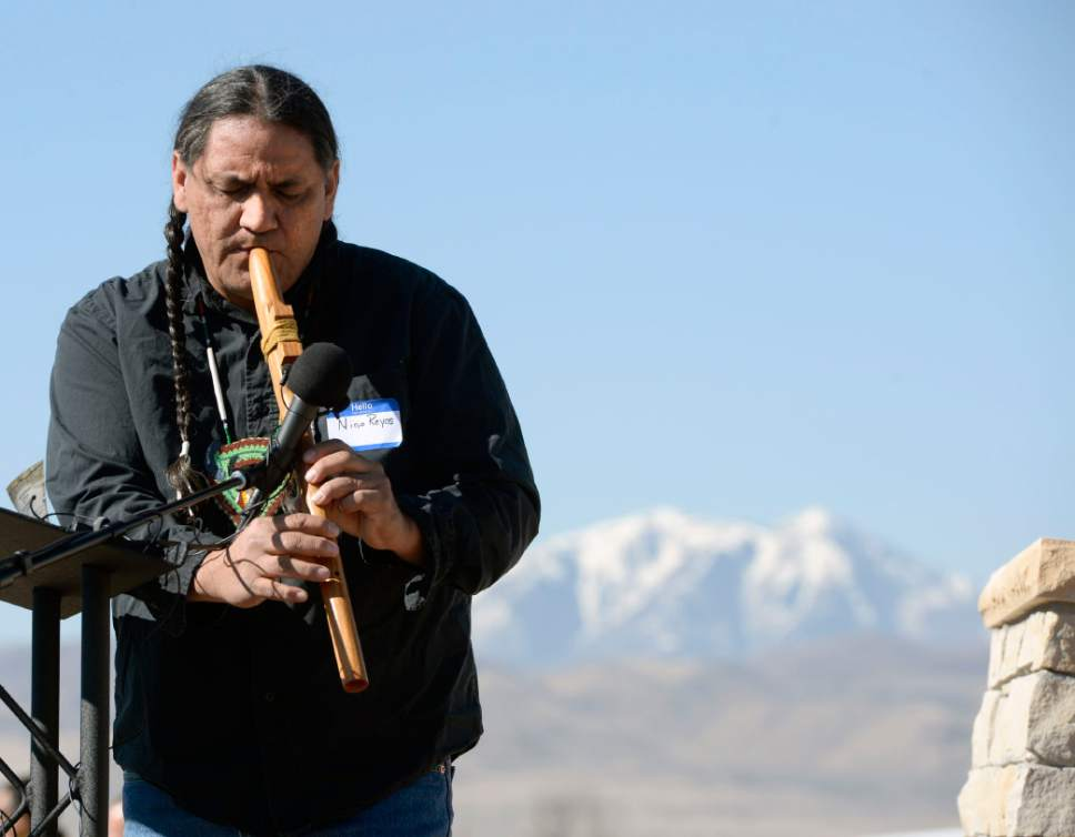 Al Hartmann  |  The Salt Lake Tribune  Nino Reyos plays traditional flute at the Galena Sundial Monument dedication ceremony on the Jordan River Parkway Friday March 27.  Once there was controversy over FrontRunner violating an Indian burial ground in the area, and this sundial was part of the promised mitigation.