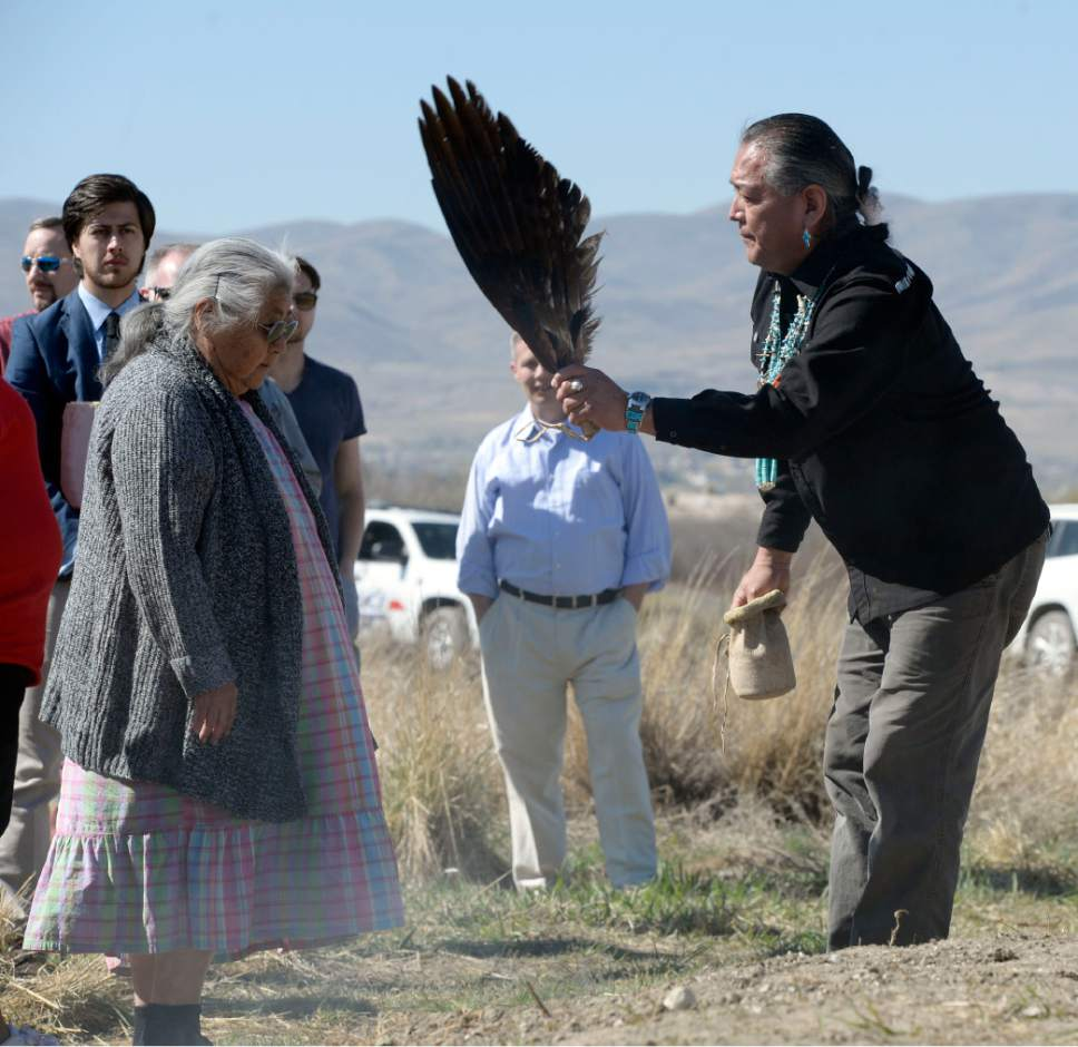 Al Hartmann  |  The Salt Lake Tribune  Julius Chavez, does blessing and prayer with Eagle wing and cedar smoke for Orlena McCurdy, a member of the Confederated Goshute tribe at the Galena Sundial Monument dedication ceremony on the Jordan River Parkway Friday March 27.  Once there was controversy over FrontRunner violating an Indian burial ground in the area, and this sundial was part of the promised mitigation.
