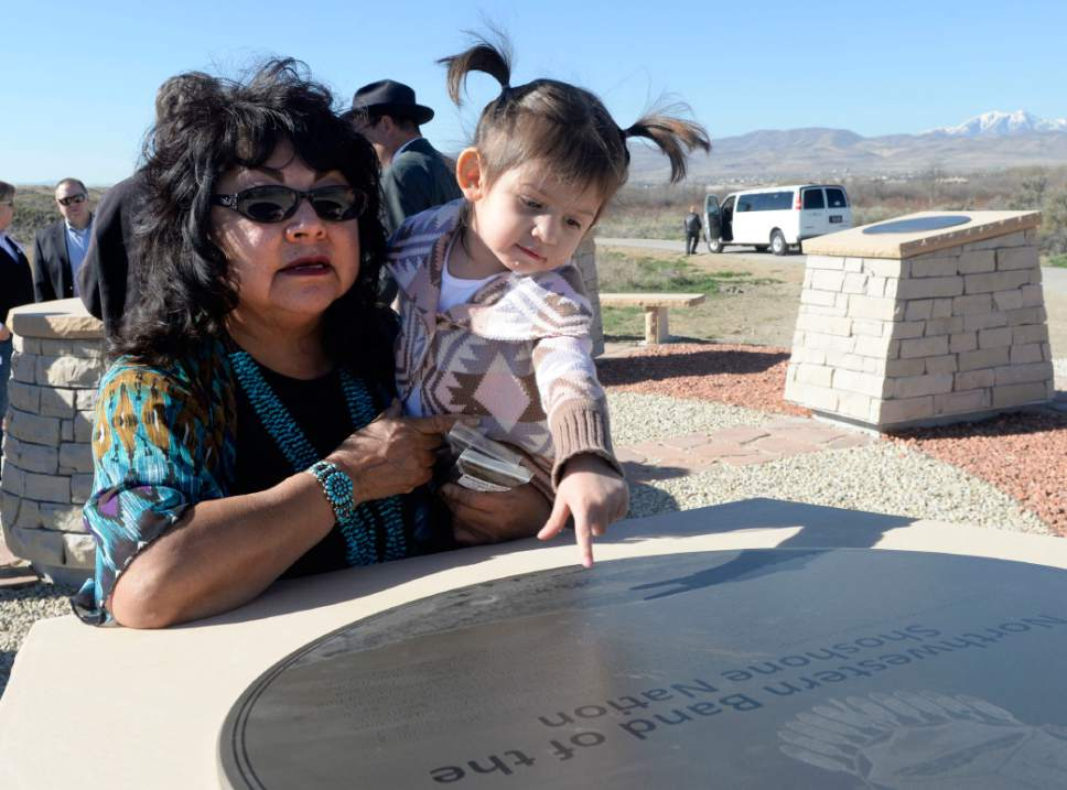 Al Hartmann  |  The Salt Lake Tribune  Shirley Silversmith, Director Utah Division of Indian Affairs and her granddughtger Presley Erickson take a look at one of the points of an Indian sundial that UTA, Utah Indian tribal leaders and Gov. Gary Herbert dedicated on the Jordan River Parkway Friday March 27. Once there was controversy over FrontRunner violating an Indian burial ground in the area, and this sundial was part of the promised mitigation.