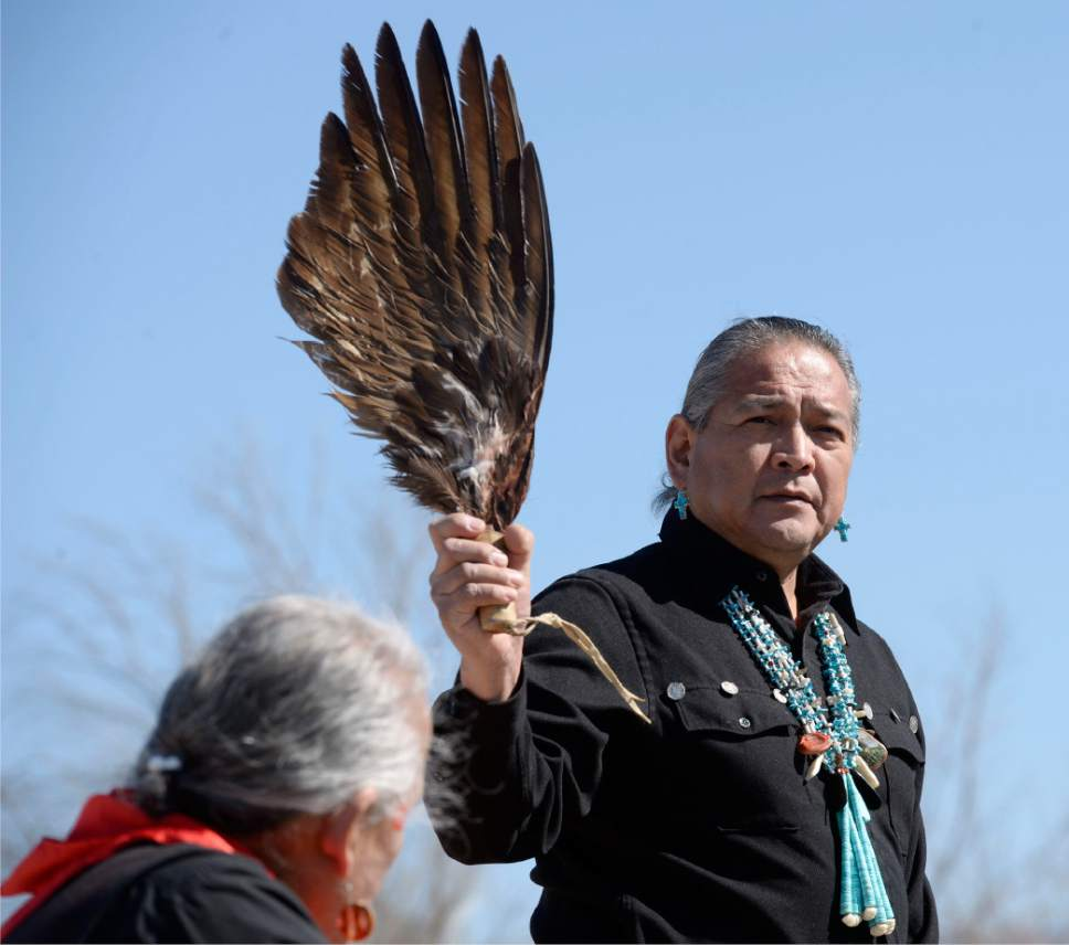 Al Hartmann  |  The Salt Lake Tribune  Julius Chavez, does blessing and prayer with Eagle wing and cedar smoke at the Galena Sundial Monument dedication ceremony on the Jordan River Parkway Friday March 27.  Once there was controversy over FrontRunner violating an Indian burial ground in the area, and this sundial was part of the promised mitigation.