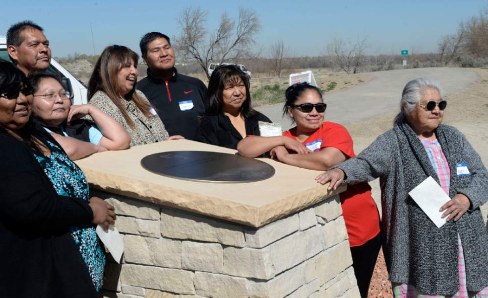 Al Hartmann  |  The Salt Lake Tribune  Members of the Goshute Confederated Tribe gather for a photo around one of the points of the Galena Sundial Monument that represents them.   UTA, Governor Gary Herbert and members of Utah's Indian tribes gathered for a dedication ceremony on the Jordan River Parkway Friday March 27.  Once there was controversy over FrontRunner violating an Indian burial ground in the area, and this sundial was part of the promised mitigation.