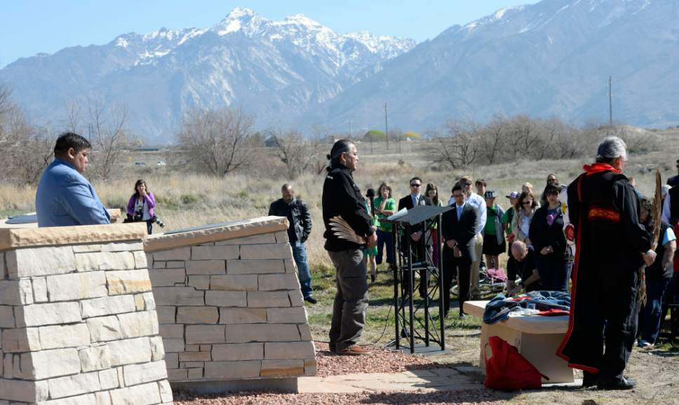 Al Hartmann  |  The Salt Lake Tribune  Julius Chavez, center, does blessing and prayer at the Galena Sundial Monument dedication ceremony on the Jordan River Parkway Friday March 27.  Once there was controversy over FrontRunner violating an Indian burial ground in the area, and this sundial was part of the promised mitigation.