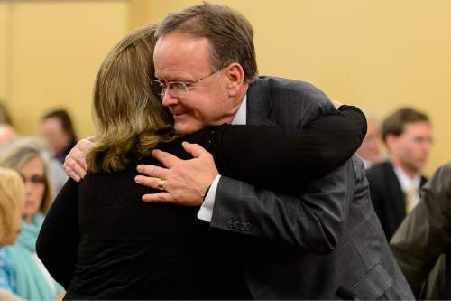 Trent Nelson  |  The Salt Lake Tribune Sen. Stuart Adams embraces Robin Wilson, a professor of law from the University of Illinois, after his bill SB297 - Protections for Religious Expression and Beliefs about Marriage, Family, or Sexuality, passed out of the House Judiciary Standing Committee, Wednesday March 11, 2015.