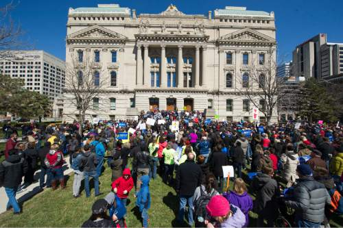 Thousands of opponents of Indiana Senate Bill 101, the Religious Freedom Restoration Act, gathered on the lawn of the Indiana State House to rally against that legislation Saturday, March 28, 2015. Indiana's law has been widely criticized by businesses and organizations around the country. (AP Photo/Doug McSchooler)